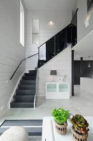 black staircase black stairs staircase scandinavian with and white floor pillows poufs