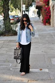 maxi dress with a tshirt over it denim jacket and gold chain
