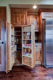 knotty hickory cabinets kitchen rustic hickory cabinets with swing out pantry country living