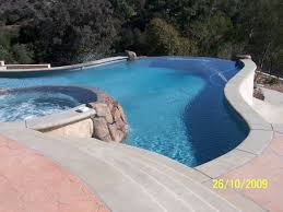 exterior design with a infinity pool resurfacing ground slide