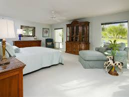 traditional master bedroom with ceiling fan u0026 carpet in palm