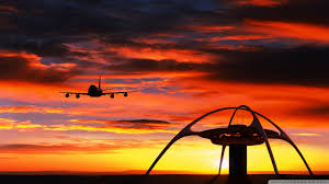airplane ling in front of a sunset wallpapers hd free 233548
