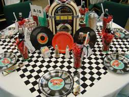 more seasonal table setting ideas to try  matt and shari with another table next to mine was this fabulous s themed table the  centerpiece was a tabletop jukebox that actually did play music and it was  surrounded by  from mattandsharicom