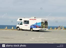 rental rv at beach parking lot on cape cod massachusetts usa stock