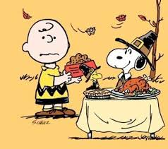 brown with snoopy and woodstock at thanksgiving table