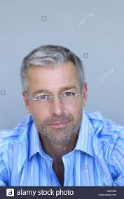 looking with grey hair man middle age glasses gaze camera portrait series men s