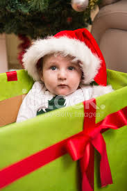 baby boy christmas baby boy in large christmas present stock photos freeimages
