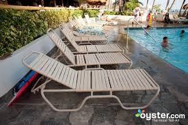 lounge chairs at the pool pre renovation at the outrigger