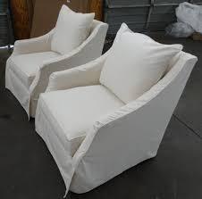 slipcovered swivel chair barnett furniture robin brucekate