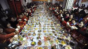 table full of food chinese new year 2018 what to eat on lunar new year for good luck