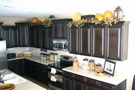 how to decorate top of kitchen cabinets kitchen decorating ideas above cabinets lovely decorating top