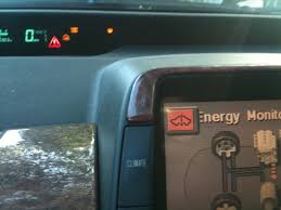 2002 toyota prius warning lights red triangle check icon and problem followed by red car icon on