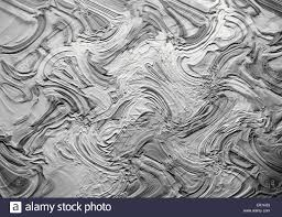 abstract relief pattern zigzag shape in gray shades stock photo