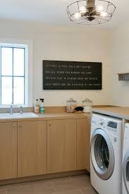 deep laundry room cabinets honey veneer laundry room cabinets with veneer countertops