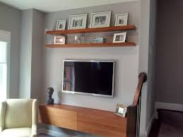 floating media cabinet and shelves with wall mounted tv yelp