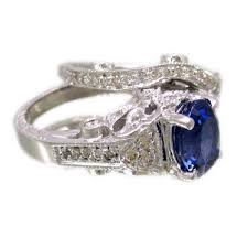 14k white gold 2 65ctw oval sapphire and round cut diamonds art