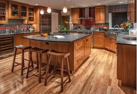 stained kitchen cabinets with hardwood floors light hardwood floor with medium stained cabinets