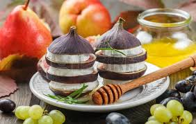 gourmet pears set of cheeses with fruit and honey camembert grapes