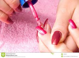 young woman with long nails make the manicure royalty free stock
