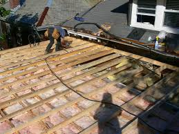 framing a flat roof with slight pitch in preparation for roofing