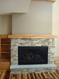 home accecories low wide fireplace with tv mounted above