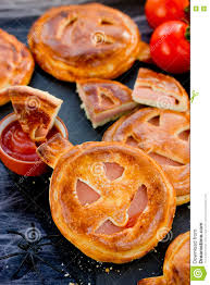 funny and scary pumpkin pizza halloween recipe stock photo image