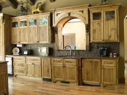 interior wooden cabinets with arch mirror and tile backsplash