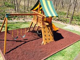 this extreme cedar swing set offers a tire swing rock climbing