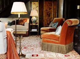 scroll back chairs uphosltered in orange velvet with bullion