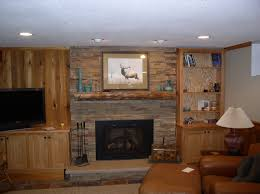 simple mantel for stone fireplace surround between wooden shelfs
