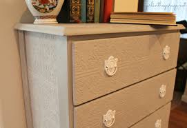 Paintable Textured Wallpaper by Textured Dresser In The Garage