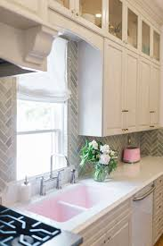 does kitchen sink need to be window how to run kitchen cabinets across a low window the leslie
