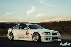 stanced porsche 911 widebody stanced bmw 325i coupe e36 widebody