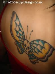 texas skull butterfly tattoo