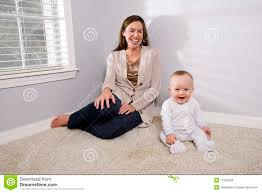 Baby Carpet Mother With Happy Baby Sitting On The Carpet Stock Photos Image