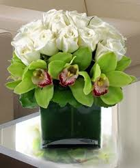 flower delivery today white roses orchids white roses and cymbidium green