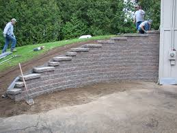 how to build a retaining wall on a slope steps of the process