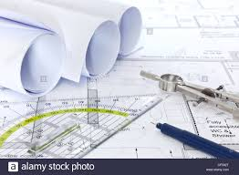 still life photo of architectural floor plans with drawing stock still life photo of architectural floor plans with drawing instruments