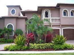 Modern Front Yard Desert Landscaping With Palm Tree And This South Florida Landscaping Has A Tropical Theme With Palm