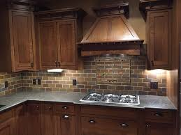 subway tile with a mod mosaics accent for a dark and woodsy