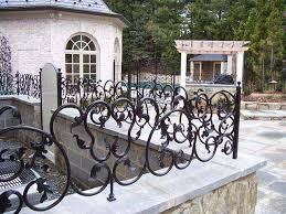 ornamental custom iron fencing for residential and commercial use