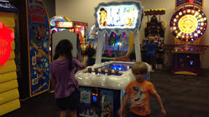 inside chuck e cheese indor game room for kids playing at chuck e