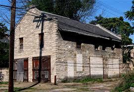 an old sandstone brick garage bikes books u0026 a little music