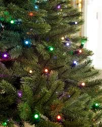 how to string christmas lights on your tree balsam hill blog