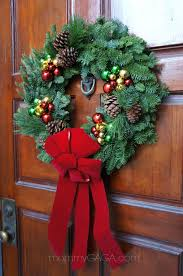 simple holiday home decorating the front door entryway with a
