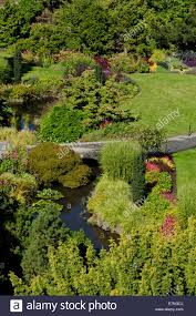 beautiful sunken gardens with flowers trees and shrubs in queen