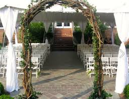 wedding arches made of branches planting new roses a farmhouse reborn