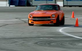 old vs new nissan project 370z against datsun 240z on the downshift
