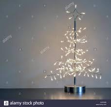 white metal tree with lightsmetal lights