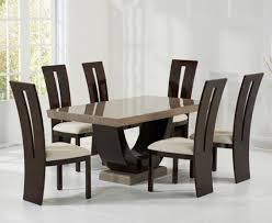 modern round marble dining table for 4 dining chairs above gloss